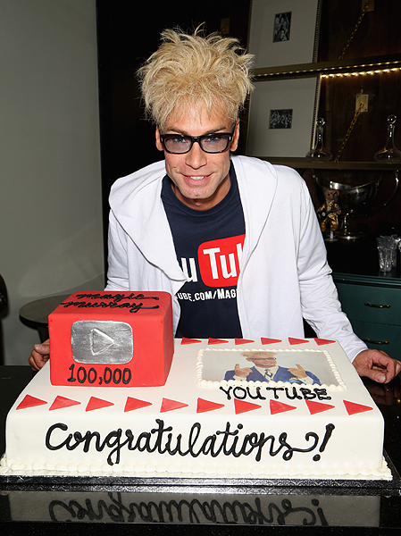 Murray with his Youtube cake - Photo credit: Gabe Ginsberg