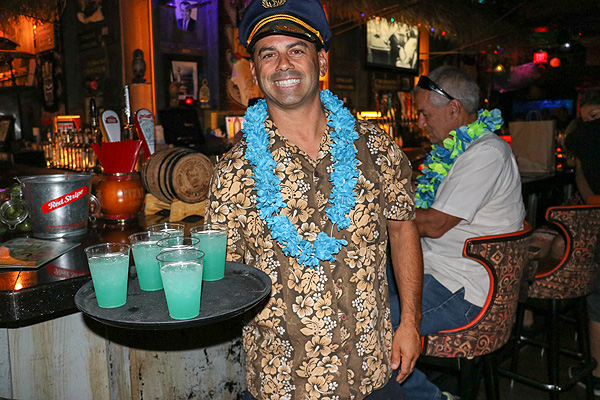 Golden Tiki General Manager Joey DAmore serves tiki punch to guests.