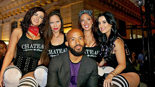 Demetrious Johnson in his VIP booth with Chateau cocktail waitresses