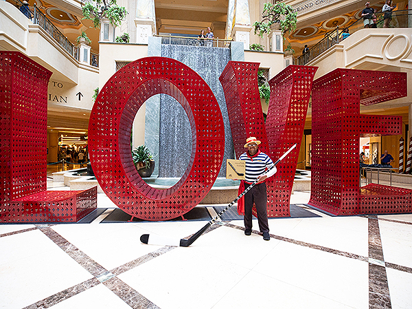 Carnell Johnson stands in front of the LOVE installation at The Venetian and The Palazzo