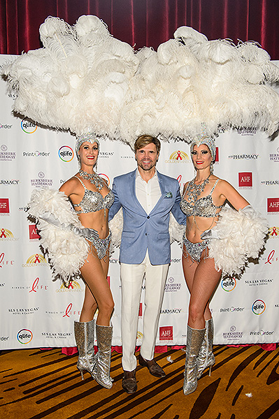 Brent Barrett poses with showgirls on the red carpet Credit Brenton Ho
