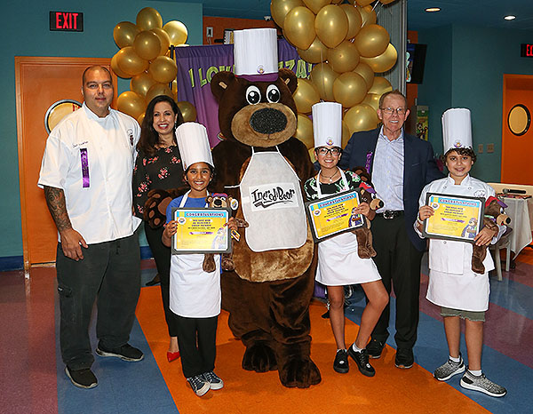 The three finalists Saniha Autumn and Omar with their prizes and Chef Joe Youkhan Maria Silva IncrediBear and John Parlet