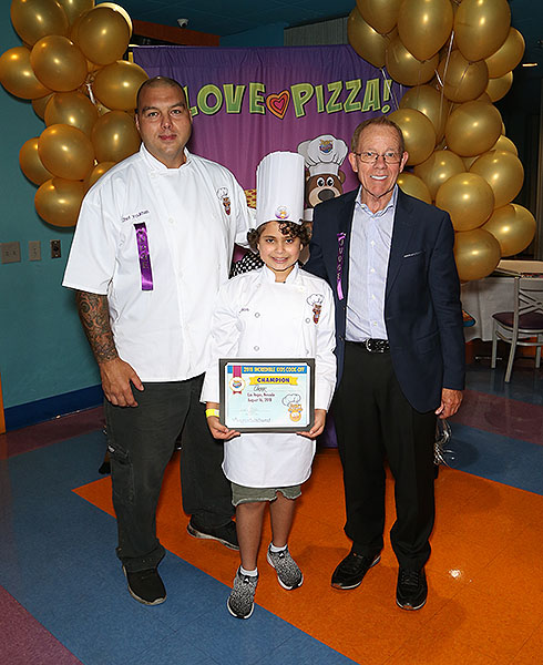 Winner of Johns Incredible Kids Cook off Omar with Chef Joe Youkhan and John Parlet