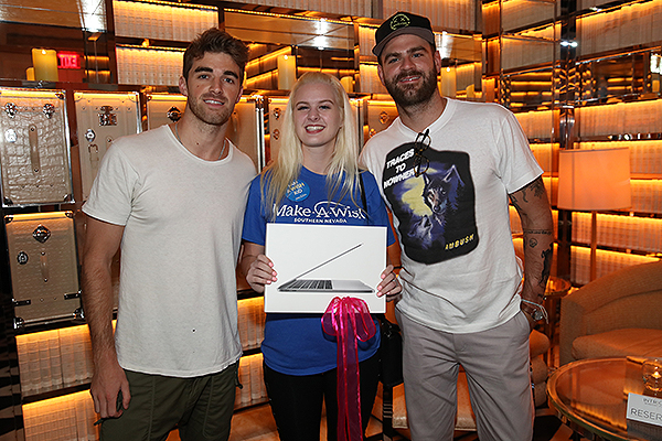Wynn Nightlife Staff and Wynn Nightlife Resident DJ Duo The Chainsmokers Present Make A Wish Recipient Sarah Hodge with a New MacBook Pro at Intrigue Nightclub Las Vegas 8.17.18 Credit Danny Mahoney for Wynn Nightlife