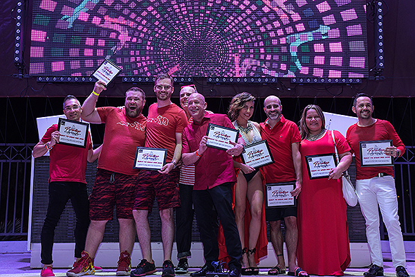 Right to wear red individuals honored on stage. Credit Amit Dadlaney