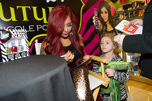 Nicole Snooki Polizzi signs autographs for fans at Perfumania in Las Vegas
