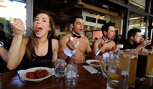 Mariah Rivera Jon Howes Juan DeAngelo and Mark Shunock competing in meatball eating contest