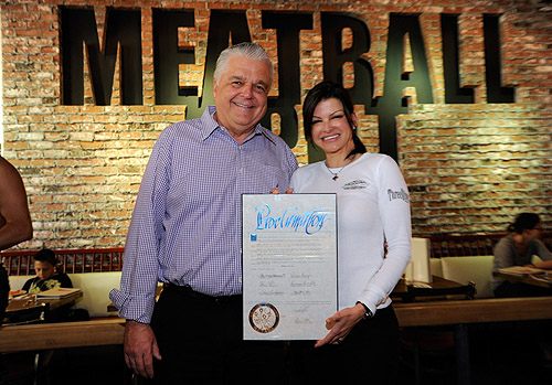 Steve Sisolak presenting Carla Pellegrino with proclamation