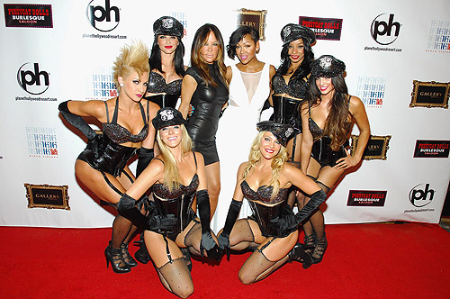 Meagan Good, Robin Antin, and Dolls on carpet