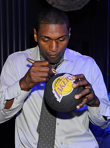 Metta_World_Peace_autographs_basketball_at_Chateau_Nightclub__Gardens