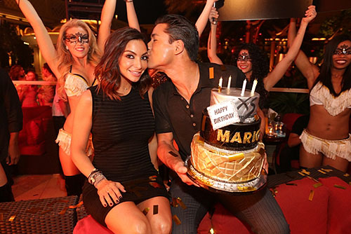 10.03.14 Mario Lopez gives his wife a kiss on the cheek at XS Nightclub