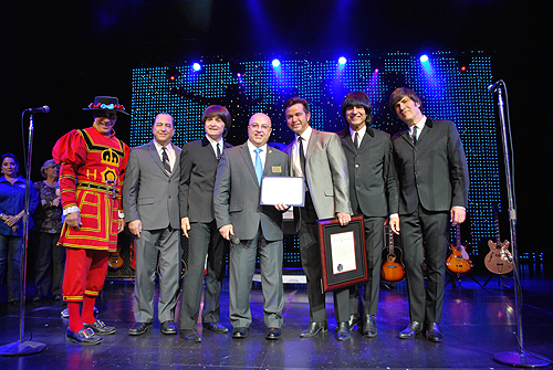 Keith Hughes from Congressman Joe Hecks office presents award to B-Beatleshow