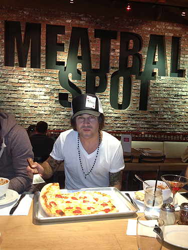 Ryan Cabrera with a pepperoni and pineapple pizza at Meatball Spot
