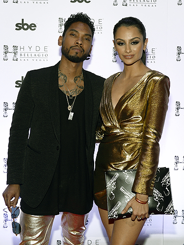 Miguel and girlfriend Nazanin Mandi pose on the red carpet at Hyde Bellagio Las Vegas 12.31.14