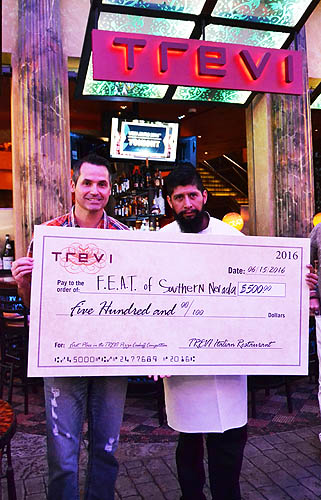 Chef Jose Presenting Winning Check to Dave Hall