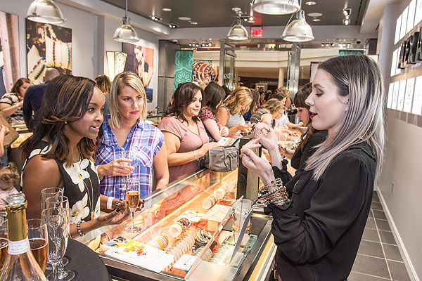 Store Director Elayna Gibson Talks To Guests at ALEX AND ANIs Fashion Show Grand Opening