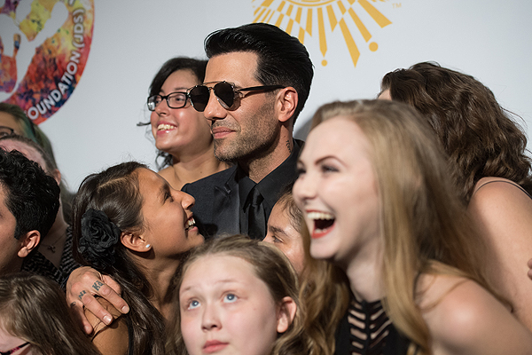 Criss Angel and The Choir Fighters on the gold carpet at Criss Angel HELP Sept 12 2016 Tom Donoghue