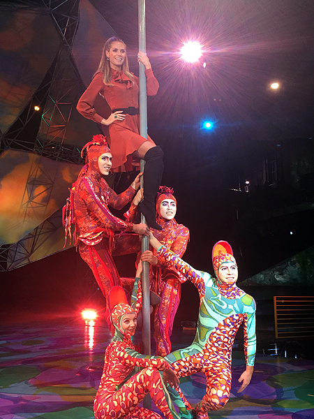 Heidi Klum tries her hand at climbing the iconic Chinese Poles featured in Mystere