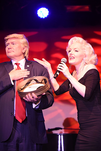 Photo 1 l to r Marcel Forestieri as Donald Trump wins 2017 Newshound Reel Award while Suzie Kennedy as Marilyn Monroe looks on Photo by Allen Dye Photography