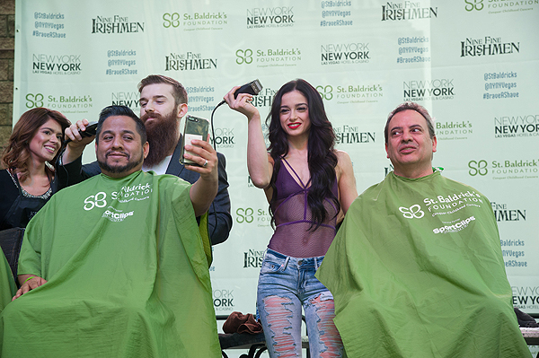 ABSINTHE cast members Billy and Emily England participate as celebrity head shavers at 8th annual St. Baldricks Day event