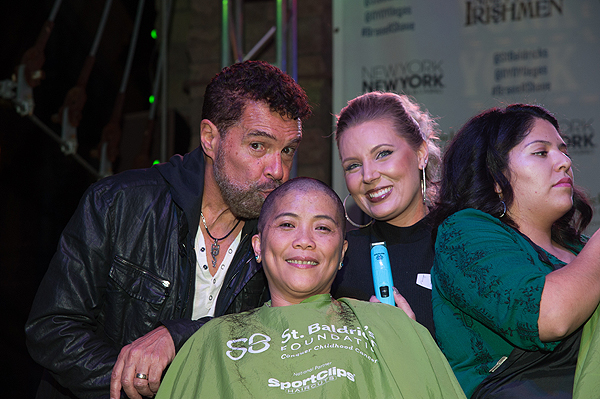 Las Vegas entertainer Clint Holmes kisses the head of a shavee at the eight annual St. Baldricks Day at New York New York Hotel Casino