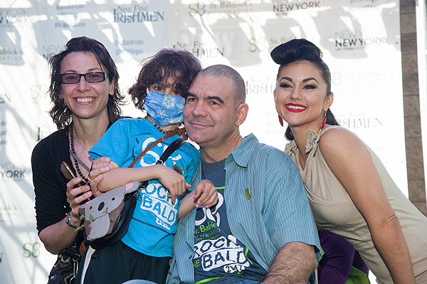 Leslie Saula and Elan Saula pose with family friend John Katsiolmetes as he gets shaved by ABSINTHE star Melody Sweets