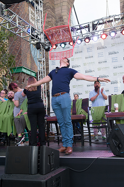 The Weekend in Vegas host Jeff Civillico performs balancing tricks during eighth annual St. Baldricks Day event at New York New York Hotel Casino